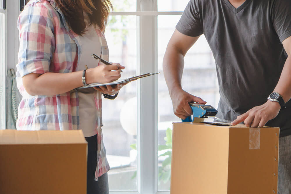 Couple Reviewing Their Moving and Packing Checklist