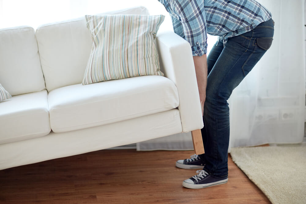 Man Moving Heavy Furniture By Himself